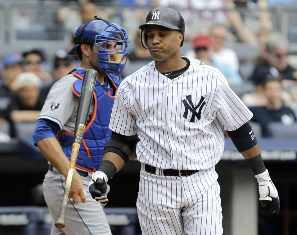 New York Yankees' Robinson Cano flips his bat