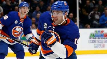 Andrew Ladd of the Islanders skates during the