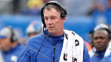 Giants head coach Pat Shurmur looks on from