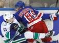 Rangers left wing Pavel Buchnevich checks Canucks defenseman
