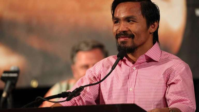 Manny Pacquiao addresses the media during the post-fight