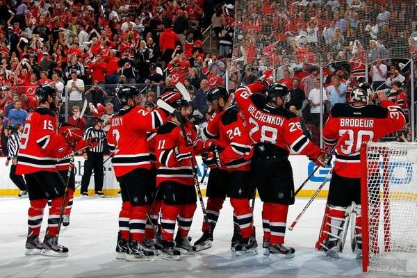 The New Jersey Devils celebrate after defeating the