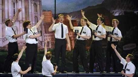 Host Neil Patrick Harris performs with the cast
