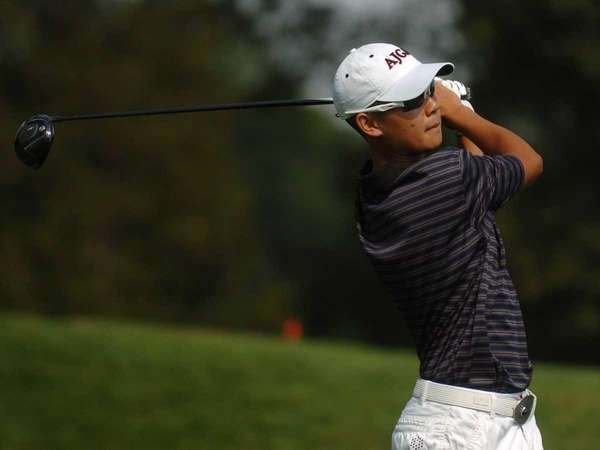 Willis Huynh of Syosset High School tees off