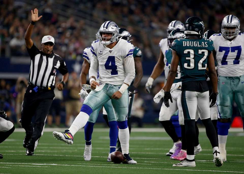 Dallas Cowboys quarterback Dak Prescott celebrates after running