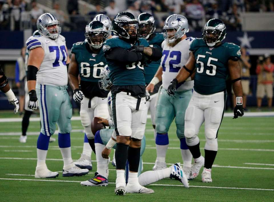 Philadelphia Eagles' Derek Barnett, center, celebrates after sacking
