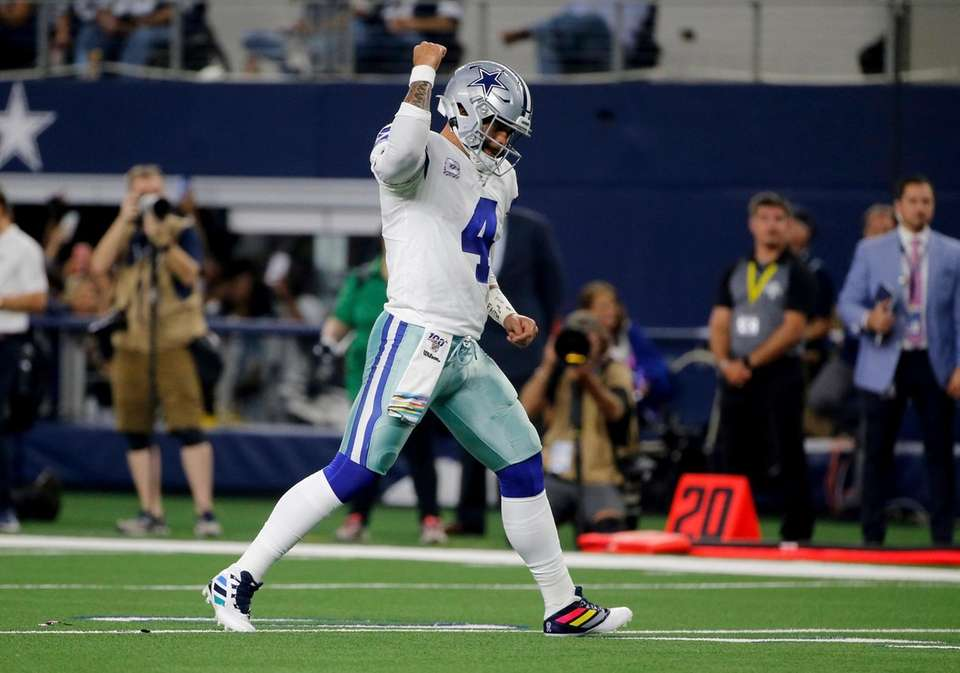 Dallas Cowboys' Dak Prescott celebrates a touchdown against