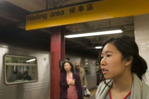 Transit activist Shanni Liang, right, translates a sign