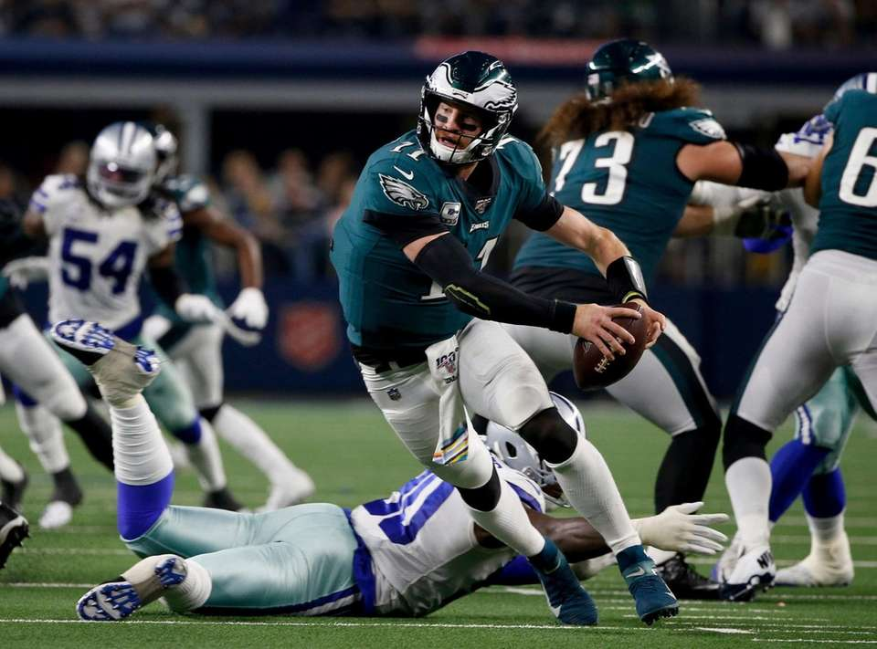 Philadelphia Eagles quarterback Carson Wentz escapes pressure from