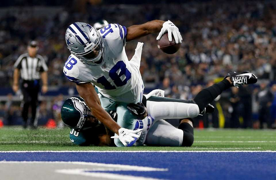 Dallas Cowboys wide receiver Randall Cobb is stopped