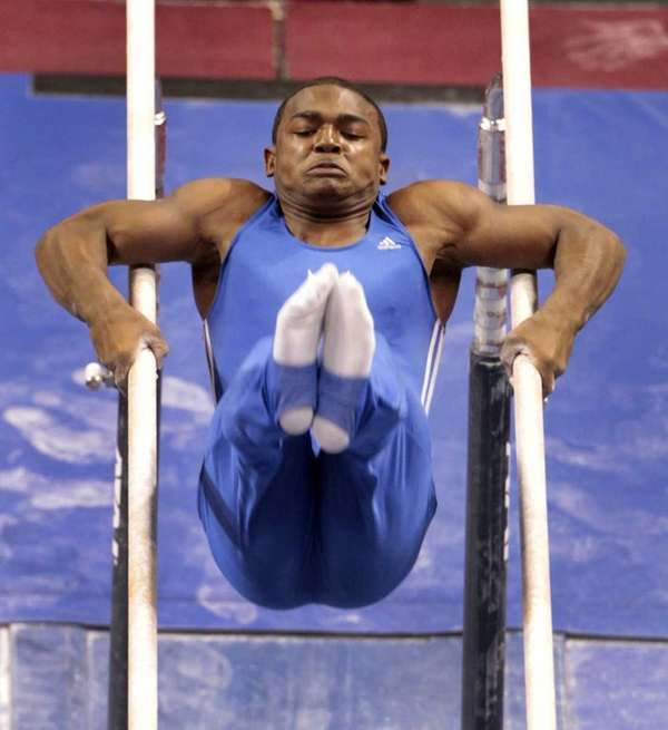 John Orozco competes in parallel bars during the
