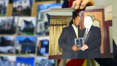 Detective Lt. Raymond Cote holds a photo of
