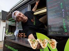 Matt Korsky holds Vietnamese-style, plant-based tacos from the