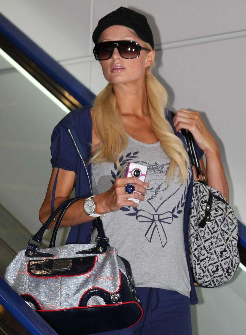 Paris Hilton arrives at a departure lounge at