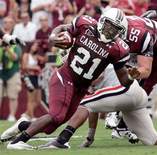 South Carolina's Marcus Lattimore (21) runs for a
