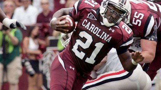 South Carolina's Marcus Lattimore (21) runs for a