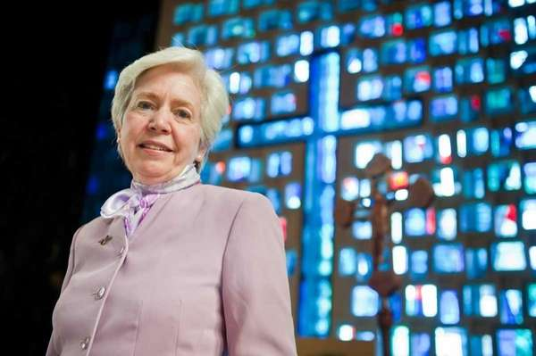 Sister Mary Hughes stands inside the chapel of