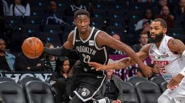 Nets guard Caris LeVert (22) moves past a
