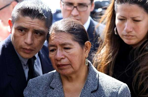 Rosario Lucero, center, stands with son Joselo Lucero,