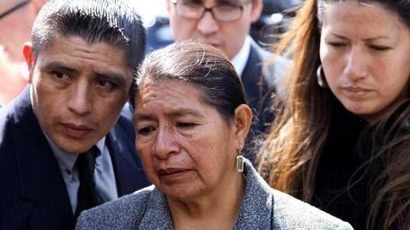 Rosario Lucero, center, stands with son Joselo Lucero,