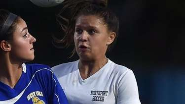Giavanna Compitello #12 of West Islip, left, and