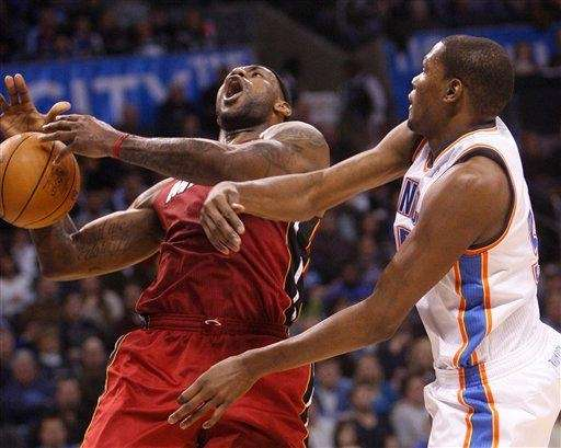 Miami Heat forward LeBron James, left, loses control