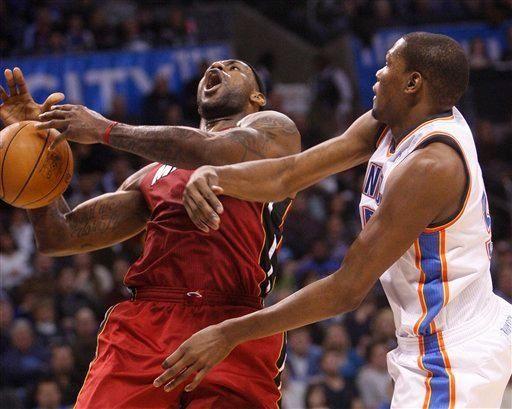 Miami Heat forward LeBron James, left, loses control
