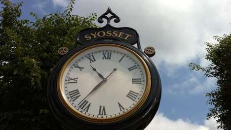 A clock keeps time in downtown Syosset. (May