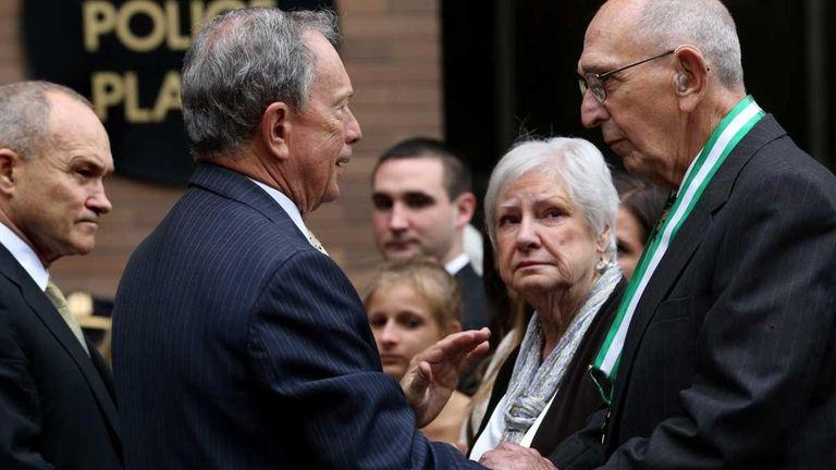 Mayor Michael Bloomberg shakes hands with Frank Figoski,