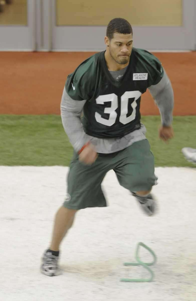 New York Jets safety LaRon Landry #30 runs