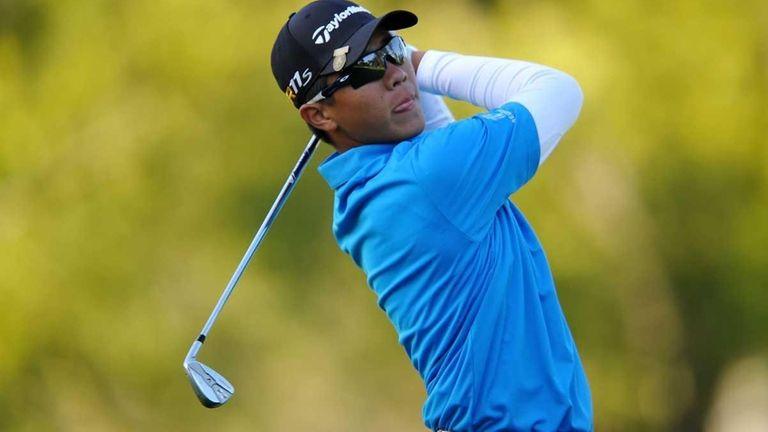 Andy Zhang of China hits a shot during