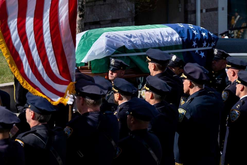 The casket carrying NYPD officer Brian Mulkeen arrives