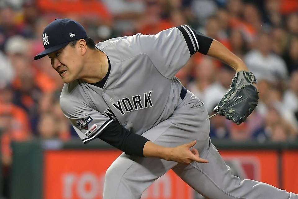 Yankees starting pitcher Masahiro Tanaka pitches in the