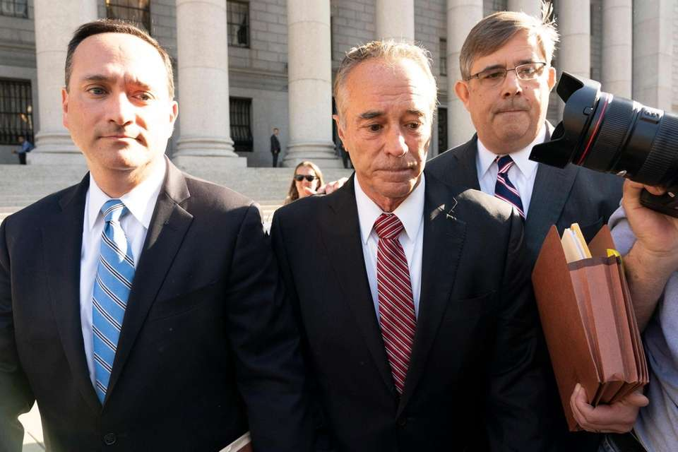 Former U.S. Rep. Chris Collins, center wearing a