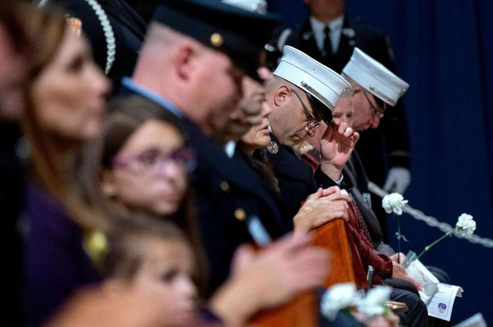 Families of eight FDNY members who died in