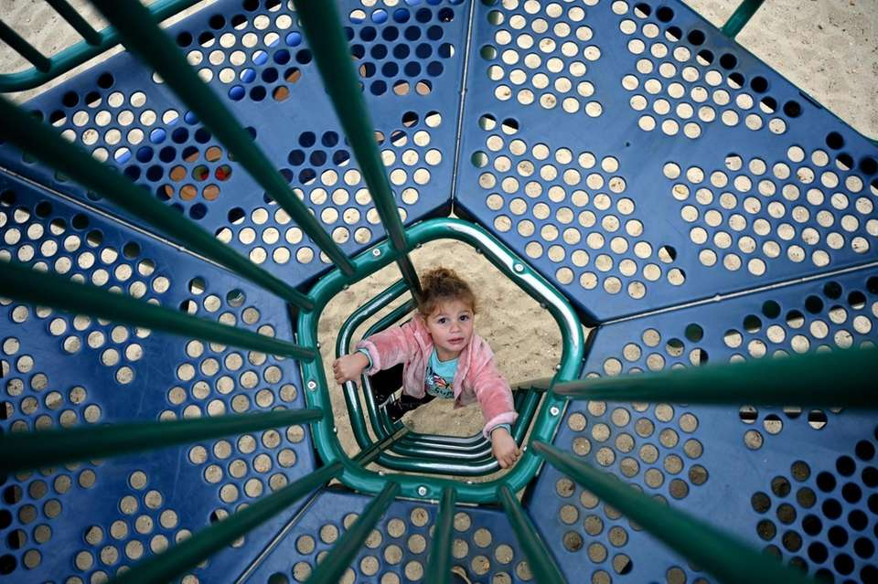 Hailey Ambrose, 2, of West Islip, plays at