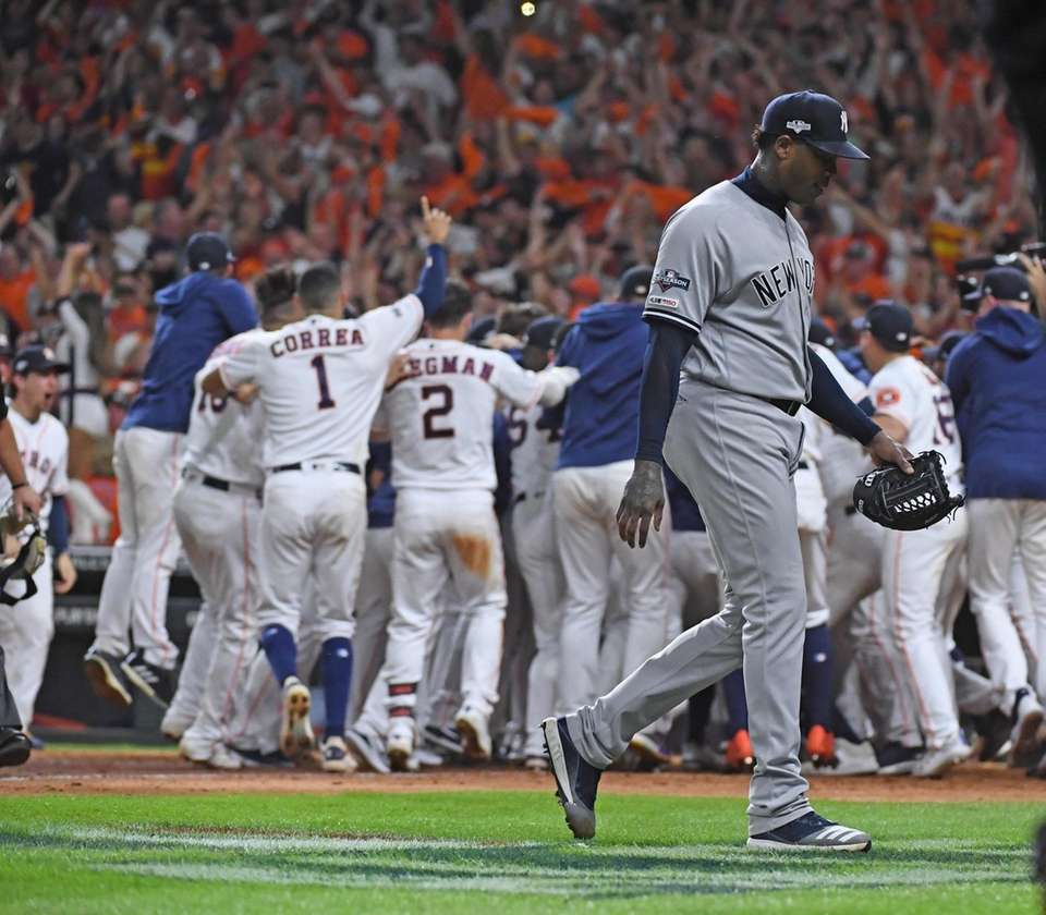 Yankees relief pitcher Aroldis Chapman walks off as