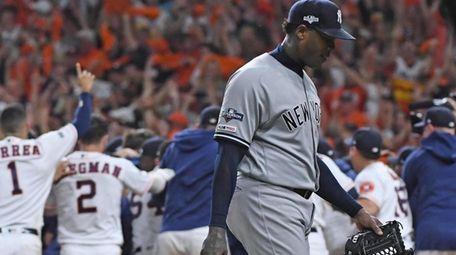 Yankees relief pitcher Aroldis Chapman walks off as
