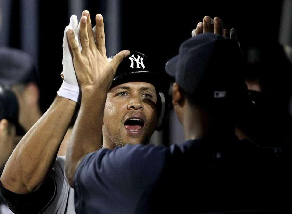 New York Yankees' Alex Rodriguez, left, gets a