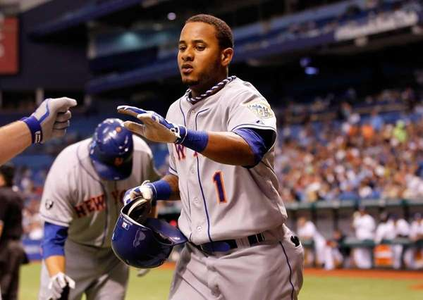 Designated hitter Jordany Valdespin is congratulated after scoring