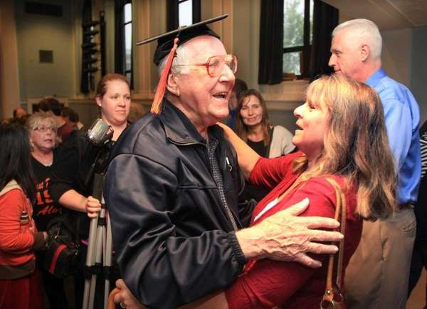 John Rieder, 85, is congratulated by former neighbor,