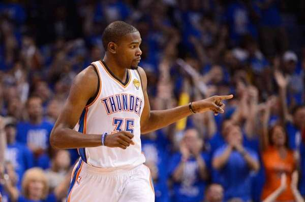 Kevin Durant reacts in the third quarter of