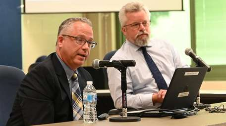 Tim Laube, left, the Eastport-South Manor district's assistant