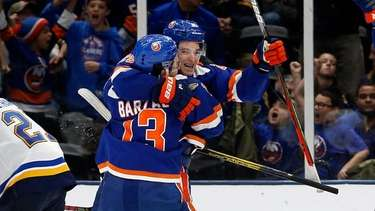Devon Toews #25 of the Islanders celebrates his