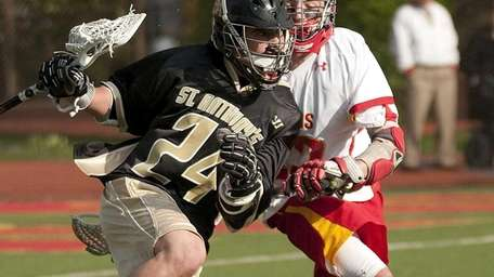 St. Anthony's Adam Pomper drives for the goal