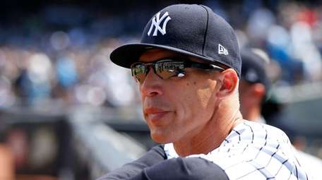 Joe Girardi looks on before the Opening Day