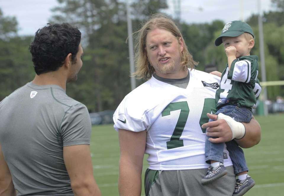 Jets quarterback Mark Sanchez, left, talks with center