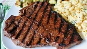 A grilled T-bone steak that's been rubbed with