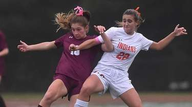Alivia Gordon #10 of Garden City, left, gets