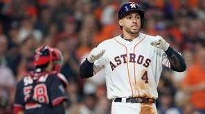 Houston Astros' George Springer reacts after striking out